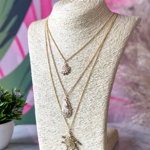 collar dorado con dijes de estrellas de mar - ropa gallardo - ecuador - accesorios